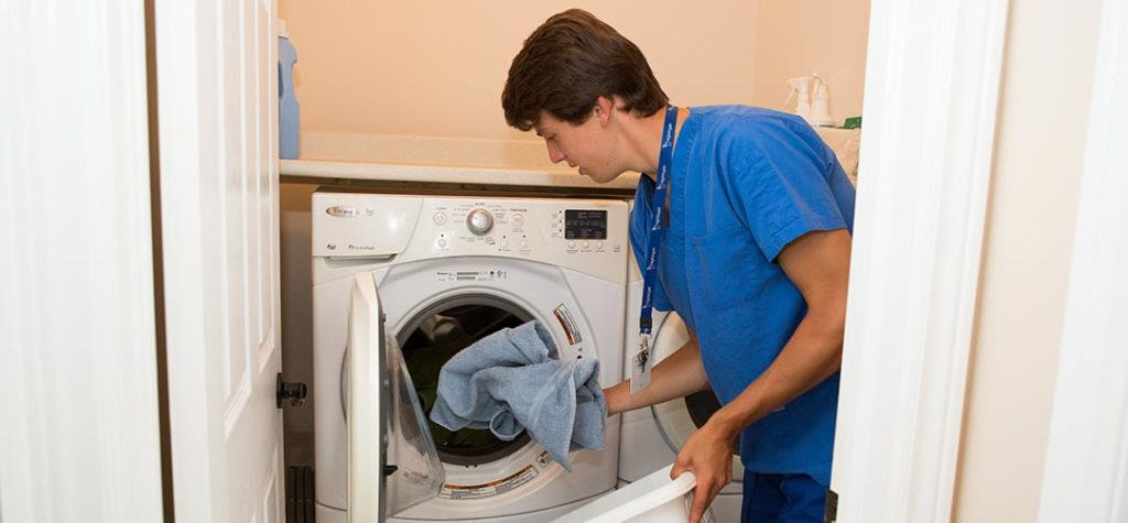 Male nurse doing laundry